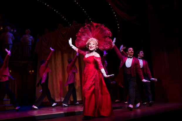 [Bette Midler (center) leads the Broadway revival of Hello, Dolly!, directed by Jerry Zaks, at the Shubert Theatre.