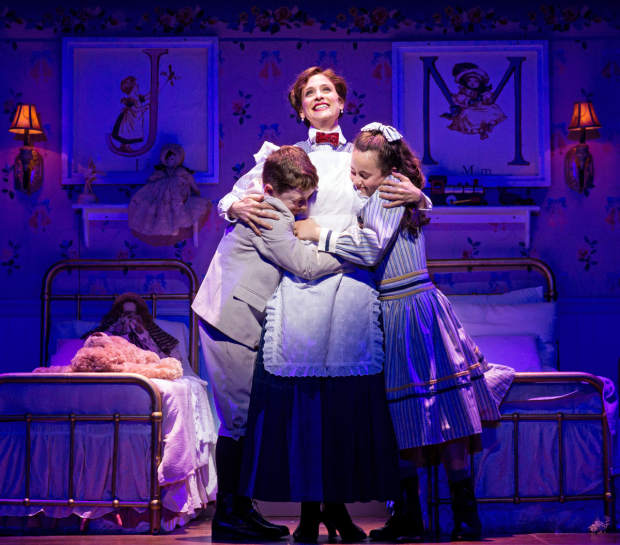 Elena Shaddow as Mary Poppins with John Michael Pitera as Michael Banks and Abbie Grace Levi as Jane Banks in Mary Poppins, directed by Mark S. Hoebee, at Paper Mill Playhouse.