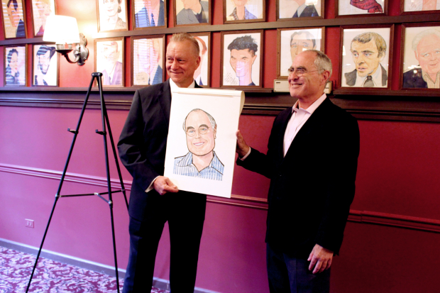 Todd Haimes (right) receives his portrait.