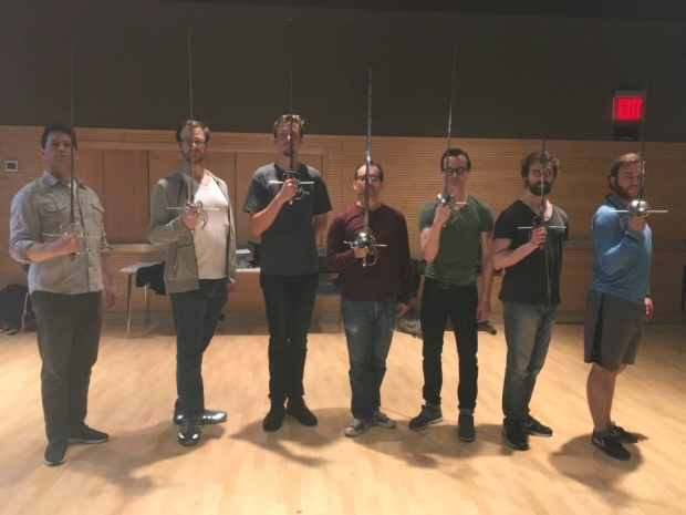 The cast of Hudson Warehouse's The Three Musketeers prepares for its first fight rehearsal.
