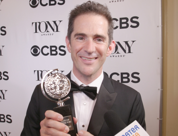 Andy Blankenbuehler shows off his Tony Award.