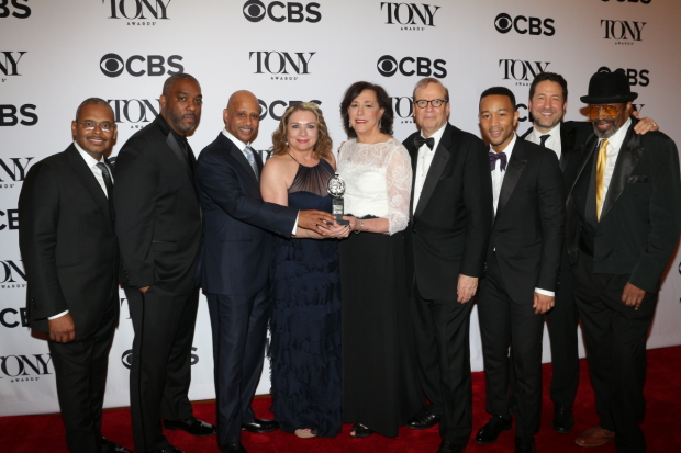 The talented team of Jitney shows off their Tony for Best Play Revival.
