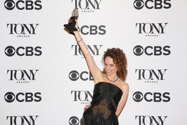 Indecent's Rebecca Taichman holds up her Tony for Best Director of a Play.