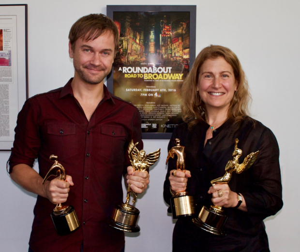 A Roundabout Road to Broadway's director Andrew Lawton and Roundabout Theatre executive director Julia Levy holding the film's four awards.