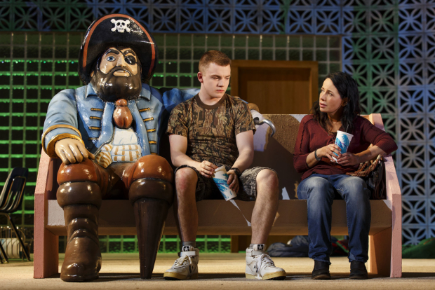 Jack DiFalco and Janeane Garofalo sit next to a pirate.