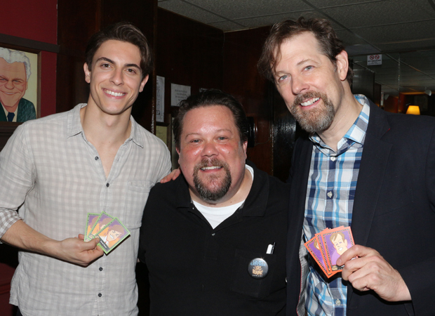 Anastasia stars Derek Klena and John Bolton show off their trading cards with artist Squigs (center).