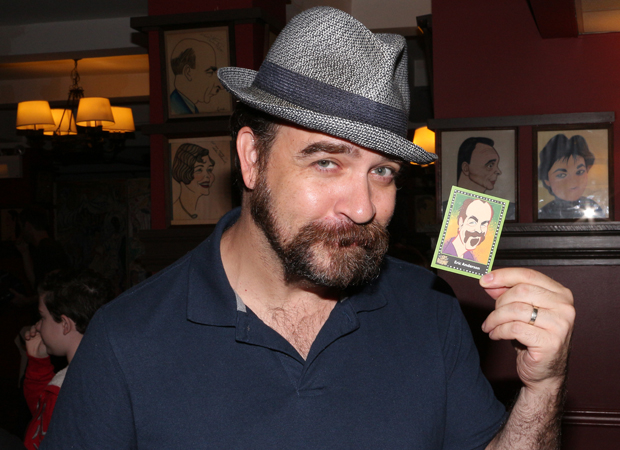 Waitress star Eric Anderson shows off his Lights of Broadway trading card.