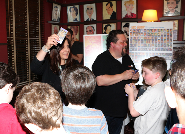 "Dori Berinstein and Justin ""Squigs"" Robertson pass out Lights of Broadway show cards."