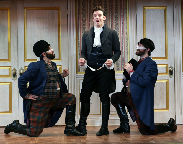 Ryan Garbayo, Michael Urie, and Ben Mehl in a scene from The Government Inspector.