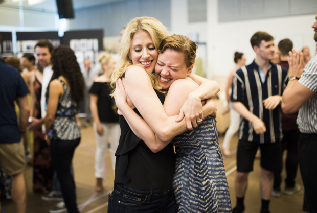 On stage sisters Caissie Levy and Patti Murin embrace on the first day of rehearsals for Frozen, directed by Michael Grandage.