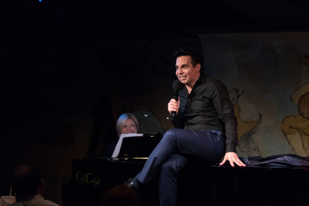 Mary-Mitchell Campbell looks on as Mario Cantone regales the Café Carlyle audience with an outrageous story.