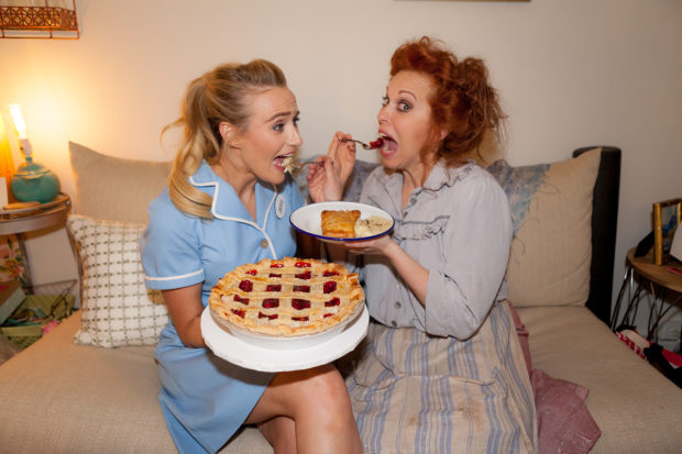 Betsy Wolfe and Carolee Carmello help themselves to a little pre-show pie.