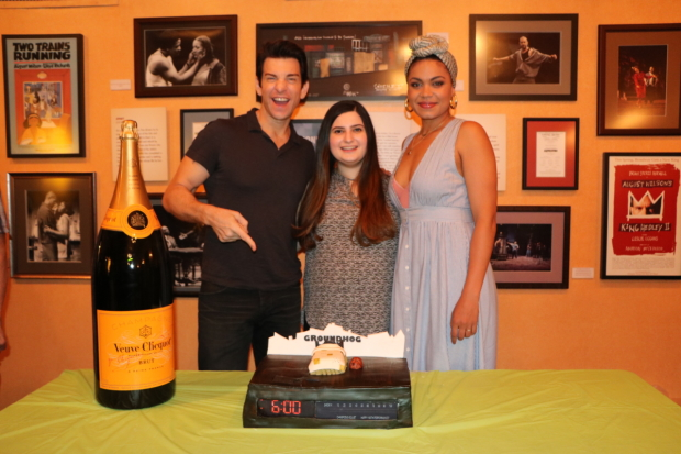 Andy Karl (left) and Barret Doss (right) celebrate 100 performances of Groundhog Day with a unique cake baked by Dina Jawetz.