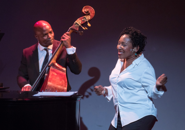 Andrea Frierson (right) shares the stage with Richie Goods (left) on the bass.