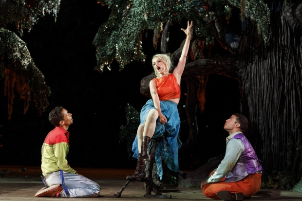 Annaleigh Ashford commands the attention of Kyle Beltran (left) and Alex Hernandez (right) in A Midsummer Night's Dream, directed by Lear deBessonet, at the Public Theater's Delacorte Theater.