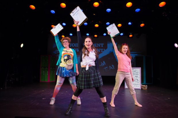 Mathletes Barbie (Madison Kauffman, left), Mary Kate (Danielle Davila, center), and Amber (Tiffany Tatreau) brandish their clipboards in Numbers Nerds, directed by Amber Mak, at Playwrights Horizons.