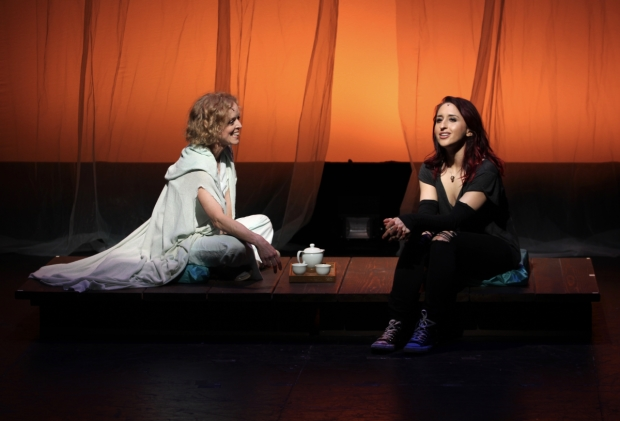 Mama Sid (Nancy Anderson, left) and Raina (Samia Mounts) enjoy tea and each other's company in The Fourth Messenger, directed by Matt August, at the Acorn Theatre.