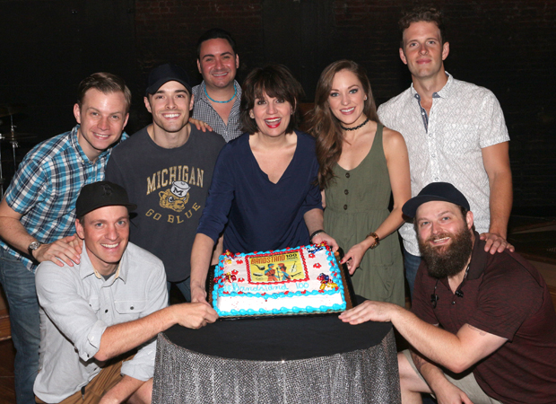 Geoff Packard, James Nathan Hopkins, Corey Cott, Joey Pero, Beth Leavel, Laura Osnes, Joe Carroll, and Brandon J. Ellis pose with their cake.
