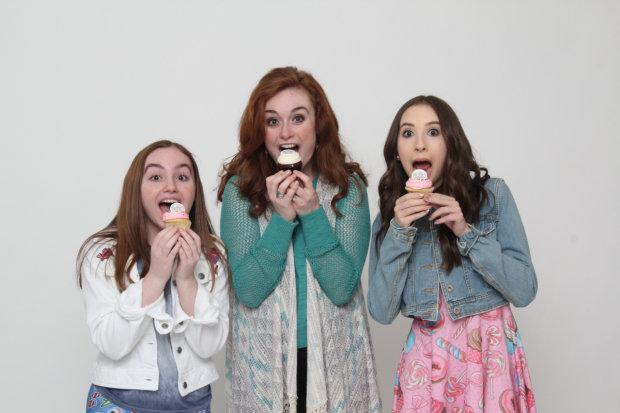 Madison Mullahey, Calli McRae, and Carrie Berk star in Peace, Love, and Cupcakes': The Musical, directed by Rommy Sandhu, for NYMF at the Acorn Theatre.