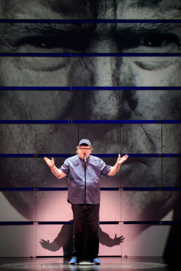 Michael Moore takes the stage at the Belasco Theatre.