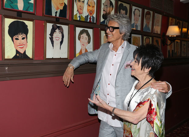 Tommy Tune and Chita Rivera have a laugh at her portrait.