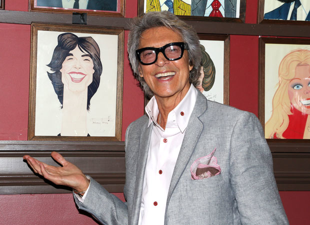 Tony winner Tommy Tune proudly shows of his portrait.