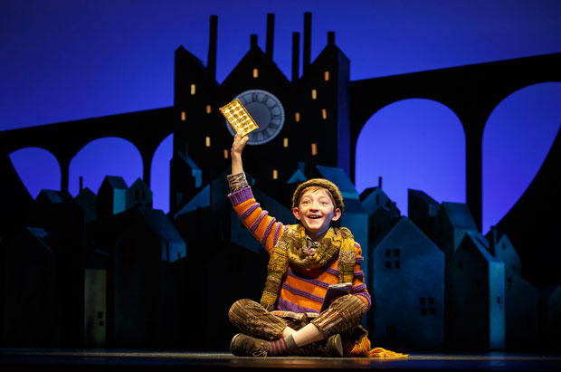 Ryan Foust as Charlie Bucket in Charlie and the Chocolate Factory, which announced a digital lottery for all performances starting today.