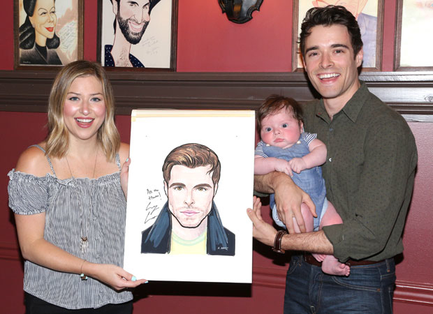 Corey Cott (right) and his family excitedly show off their newest likeness.