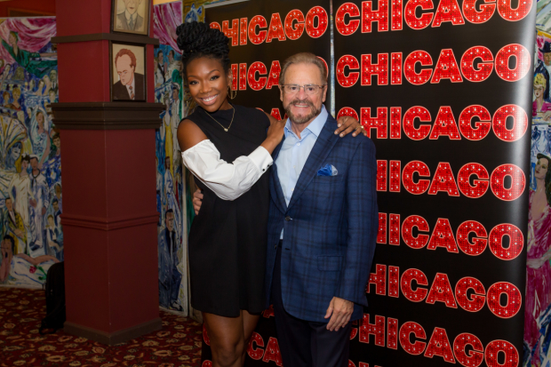 Brandy grabs a quick photo with producer Barry Weissler.