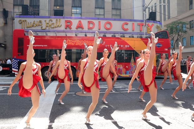 The Rockettes take Sixth Avenue to celebrate Christmas in August.