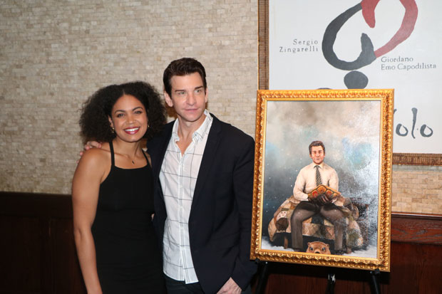 Costars Barret Doss and Andy Karl pose for a photo with the painting.
