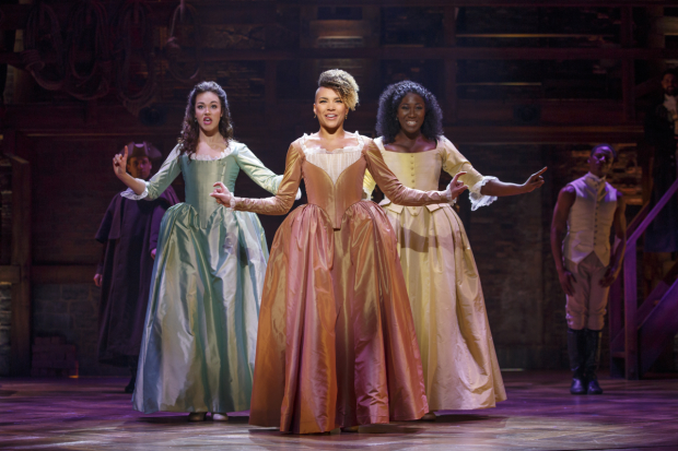Solea Pfeiffer (Eliza), Emmy Raver-Lampman (Angelica), and Amber Iman (Peggy) in the national tour of Hamilton.
