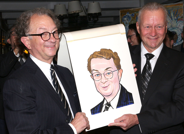 Max Klimavicius (right) helps celebrate William Ivey Long's (left) 70th birthday by presenting him with a portrait.