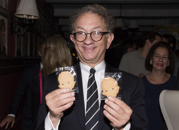 An amused William Ivey Long holds cookies made in his likeness.