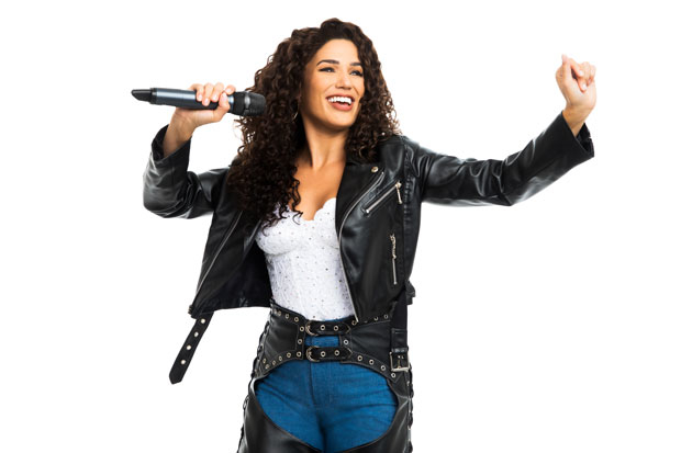 Christie Prades in a promotional image for the tour of On Your Feet!