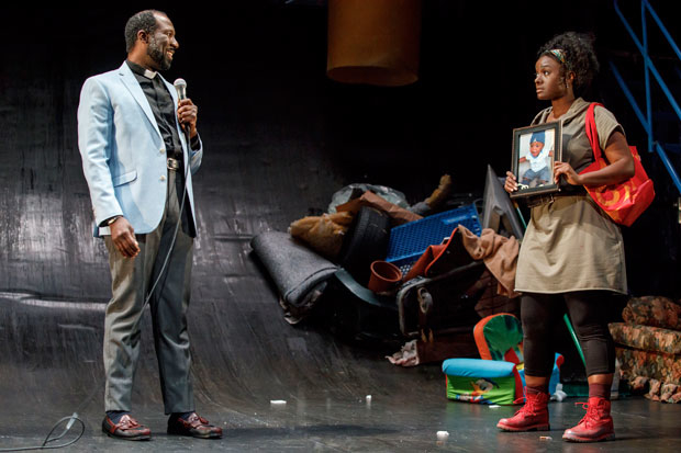 Russel G. Jones and Saycon Sengbloh in a scene from In The Blood.