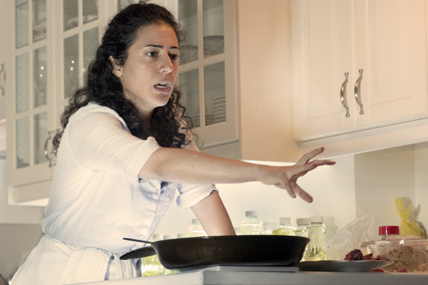 Nadine Malouf reaches for a plate of meat in Oh My Sweet Land.
