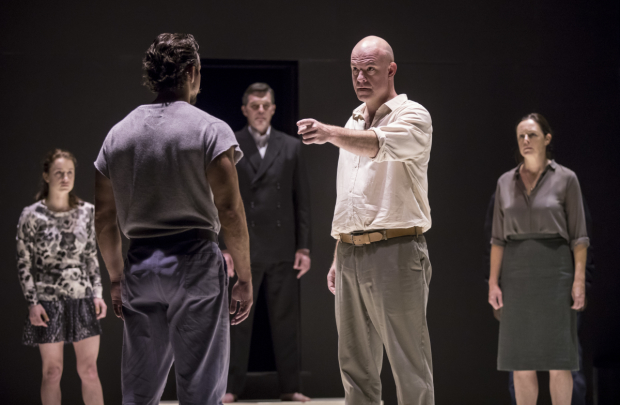 Ian Bedford (Eddie), Catherine Combs (Catherine), Brandon Espinoza (Marco), James D. Farruggio (Officer), and Andrus Nichols (Beatrice) in A View From the Bridge, directed by Ivo van Hove at the Goodman Theatre.