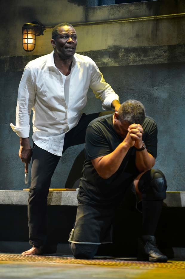 John Douglas Thompson (Hamlet) debates whether to take the life of Steven Anthony Jones (Claudius).