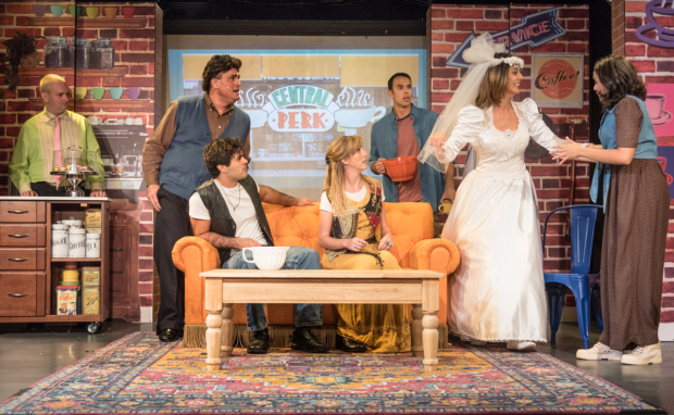 Bob McSmith (Gunther), Seth Blum (Chandler), Alan Trinca (Joey), Katie Johantgen (Phoebe), Landon Zwick (Ross), Patricia Sabulis (Rachel), and Lisa Graye (Monica) in a scene from Friends! The Musical Parody at St. Luke's Theatre.