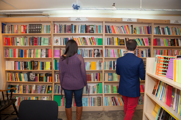 Hayley and Zach browse the shelves at the Drama Book Shop.