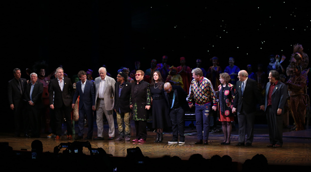 Lebo M (bowing center) takes a curtain call with Elton John, Julie Taymor, and the rest of The Lion King's original creative team at the show's 20th anniversary performance on November 5 at the Minskoff Theatre.