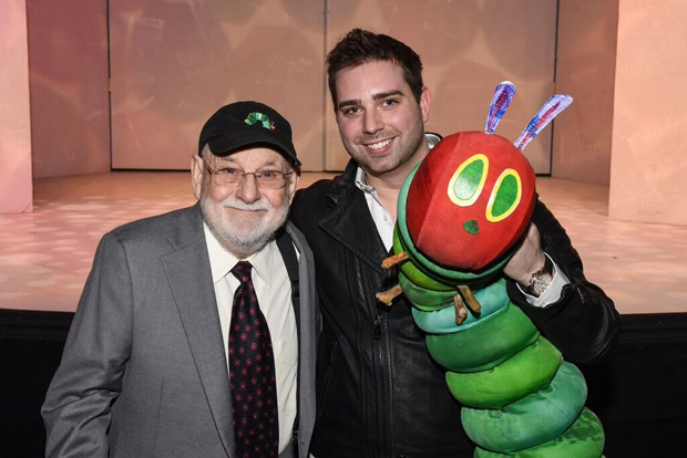 Author Eric Carle poses with Jonathan Rockefeller and The Very Hungry Caterpillar.