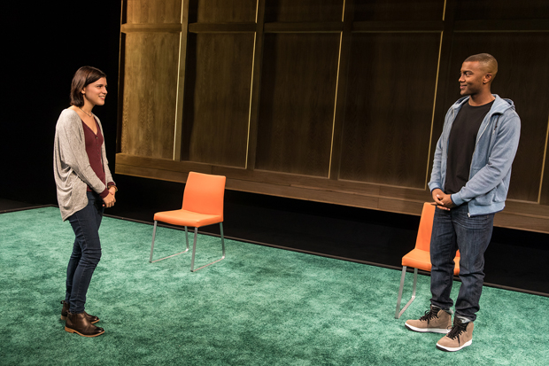 Alexandra Socha and Joshua Boone stand on Adam Rigg's set for Actually at New York City Center.