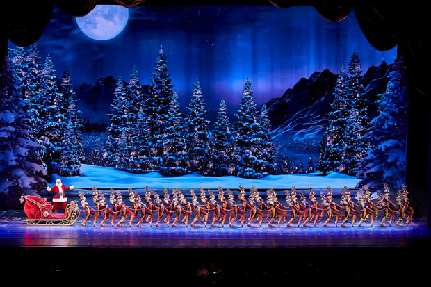 Santa Claus and the Rockettes star in the Radio City Christmas Spectacular, directed by Julie Branam, at Radio City Music Hall.