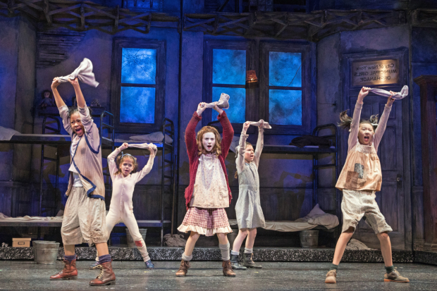 Cassidy Pry (center) as Annie, with Michelle Henderson (Duffy), Tessa Noelle Frascogna (Molly), Eve Johnson (Tessie), and Lauren Sun (July) in Annie at Paper Mill Playhouse.