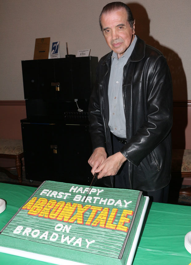 Chazz Palminteri cuts the cake.