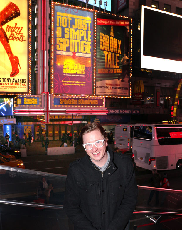 SpongeBob SquarePants book writer Kyle Jarrow poses with the musical's Broadway marquee.
