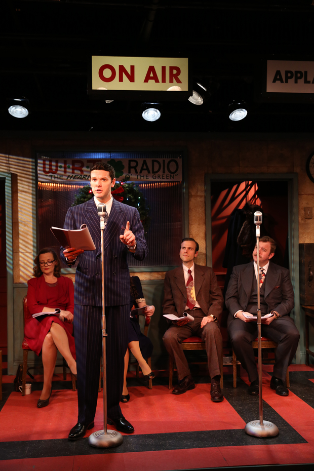 Ian Holcomb takes the mic in It's a Wonderful Life: The 1946 Live Radio Play at Irish Repertory Theatre.