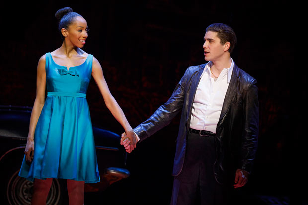Christiani Pitts and Adam Kaplan take hands in a scene from A Bronx Tale at the Longacre Theatre.